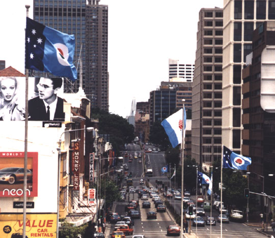 Flag display in William St - View towards the Kings Cross Tunnel from Bourke St